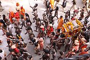 Ritual bathing in the Ganges River India, Uttarakhand, Haridwar, Kumbh Mela. A Sadhu an ascetic or practitioner of yoga (yogi) who has given up pursuit of the first three Hindu goals of life: kama (enjoyment), artha (practical objectives) and even dharma (duty).
