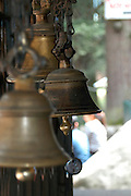 India, Vashisht near Manali, Kullu District, Himachal Pradesh, Northern India, sage Vashisht temple, also famous, for its hot sulphur springs, The bells at entrance to the shrine