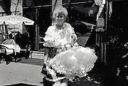 Antwerp, Belgium, 2001, A woman dressed up as a chearleader. PHOTO © Christophe VANDER EECKEN