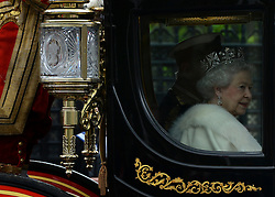 © Licensed to London News Pictures. 09/05/2012. Westminster, UK HRH Queen Elizabeth II. The procession carrying Queen Elizabeth II on its way to the Palace of Westminster today 9th May 2012. It is the first Queen's Speech, the grandest event on the parliamentary calendar, since shortly after the coalition Government was formed. The statement usually takes place each autumn. Photo credit : Stephen Simpson/LNP
