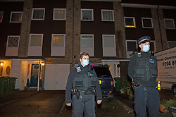 © Licensed to London News Pictures 19/01/2021.        Greenwich, UK.Police on scene in front of the property.  A murder investigation has been launched by police in Greenwich, South East London after a 74 year old man was found with a knife injury inside a residential property. He was pronounced dead at the scene. Photo credit:Grant Falvey/LNP