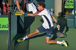 March 29, 2018 - Key Biscayne, FL, U.S. - KEY BISCAYNE, FL - MARCH 29: Pablo Carreno Busta (ESP) slides under the net during day 11 of the 2018 Miami Open held at the Crandon Park Tennis Center on March 29, 2018 in Key Biscayne, Florida.  (Photo by Andrew Patron/Icon Sportswire) (Credit Image: © Andrew Patron/Icon SMI via ZUMA Press)