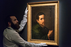 "© Licensed to London News Pictures. 29/11/2019. LONDON, UK. A technician presents ""Saint Judas Thaddeus"", 1616, by Jusepe de Ribera, called Lo Spagnoletto (Est. GBP200-300k) at the preview of Old Masters sales at Sotheby's, New Bond Street.  Works will be offered for sale on 4 and 5 December.  Photo credit: Stephen Chung/LNP"