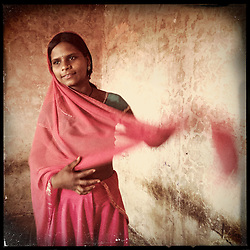 """iPhone portrait of Savita Daamor, 13, in a village outside of Banswara, Rajasthan, India, May 21, 2013. """"My father was saying he will get me married. I refused, I said, 'No. I won't get married.' I would not like it if I got married at a tender age,"""" said Daamor. <br /> <br /> Under Indian law, children younger than 18 cannot marry. Yet in a number of India's states, at least half of all girls are married before they turn 18, according to statistics gathered in 2012 by the United Nations Population Fund (UNFPA). However, young girls in the Indian state of Rajasthan—and even a few boys—are getting some help in combatting child marriage. In villages throughout Tonk, Jaipur and Banswara districts, the Center for Unfolding Learning Potential, or CULP, uses its Pehchan Project to reach out to girls, generally between the ages of 9 and 14, who either left school early or never went at all. The education and confidence-building CULP offers have empowered youngsters to refuse forced marriages in favor of continuing their studies, and the nongovernmental organization has provided them with resources and advocates in their fight."""