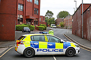 """Oldham, United Kingdom, June 21, 2021: Police arrived at the site after Palestine Action activists scaled the roof of """"Cairo House"""" in Oldham on Monday, June 21, 2021. This is the ongoing protest forms of the human rights activists group in Britain targeting an Israeli owned weapons manufacturer Elbit Systems. Activists argue that arms being manufactured in the facility are being used in indiscriminate attacks against the Gaza Strip. (VX Photo/ Vudi Xhymshiti)"""