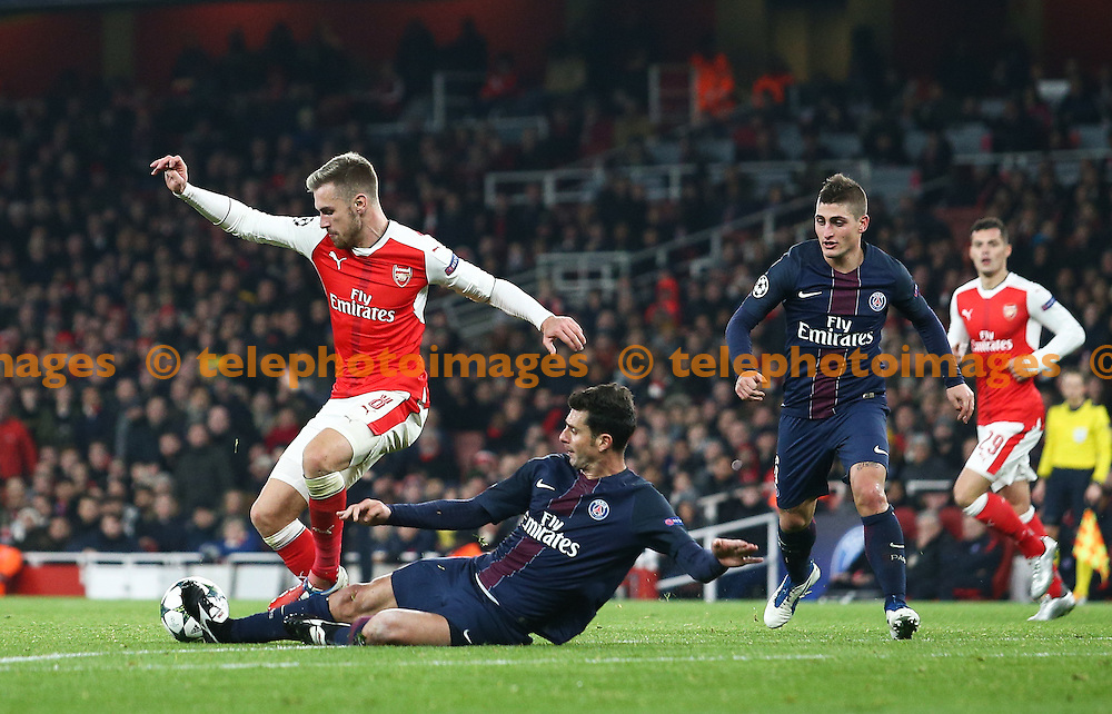 Thiago Motta of Paris Saint-Germain tackles Aaron Ramsey of Arsenal during the UEFA Champions League match between Arsenal and Paris Saint-Germain at the Emirates Stadium in London. November 23, 2016.<br /> Arron Gent / Telephoto Images<br /> +44 7967 642437