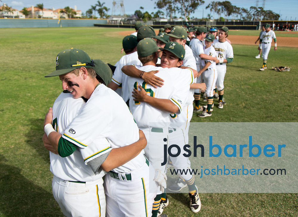 Edison's Ted Burton hugs a teammate after a 3-2 loss to Palm Desert in a CIF-SS Division 2 quarterfinal at Edison High School on Friday, May 26, 2017 in Huntington Beach, Calif. (Photo by Josh Barber, Contributing Photographer)