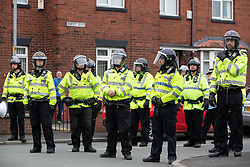 © Licensed to London News Pictures . 18/05/2019. Oldham, UK. Riot police on First Avenue separate those opposed to Yaxley-Lennon from the rally . Former EDL leader Stephen Yaxley-Lennon (aka Tommy Robinson ) continues his campaign for a seat in the European Parliament representing the North West of England , by visiting Oldham . Photo credit: Joel Goodman/LNP