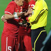 Referee's Sergii BOIKO (R) Turkey's Emre BELOZOGLU (L) during their International friendly soccer match Turkey between South Korean at the Avni Aker stadium in Trabzon, Turkey on Wednesday 09 February 2011. Photo by TURKPIX