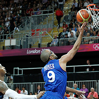 29 July 2012: Tony Parker of France goes for the layup past USA Carmelo Anthony during the 98-71 Team USA victory over Team France, during the men's basketball preliminary, at the Basketball Arena, in London, Great Britain.