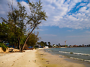 """12 FEBRUARY 2019 - SIHANOUKVILLE, CAMBODIA: The Blue Bay beach. Blue Bay is a Chinese casino and resort being built in Sihanoukville. There are about 50 Chinese casinos and resort hotels either open or under construction in Sihanoukville. The casinos are changing the city, once a sleepy port on Southeast Asia's """"backpacker trail"""" into a booming city. The change is coming with a cost though. Many Cambodian residents of Sihanoukville  have lost their homes to make way for the casinos and the jobs are going to Chinese workers, brought in to build casinos and work in the casinos.       PHOTO BY JACK KURTZ"""