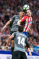 Atletico de Madrid's Diego Godin and Malaga's Adrian Gonzalez during La Liga match between Atletico de Madrid and Malaga CF at Wanda Metropolitano in Madrid, Spain September 16, 2017. (ALTERPHOTOS/Borja B.Hojas)