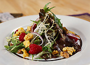 First course of fresh salad served for dinner at Winterlake Lodge, Finger Lake, Alaska.