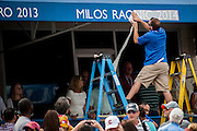 A worker puts put the name of the men's champion, Milos Raonic of Canada, at the Citi Open ATP tennis tournament in Washington, DC, USA, 3 Aug 2014. Raonic won the men's final 6-1, 6-4.