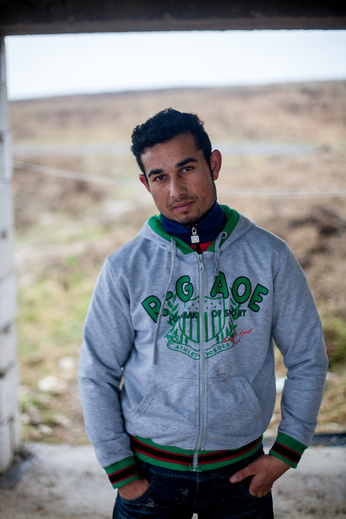 Portrait of Emil (20) at the contruction side in their village Rankovce where they joined a micro loan program to built themselves their own house. Support by the foundation ETP Slovakia which is working in Rankovce and setting up micro-loan funds for the local Roma community.