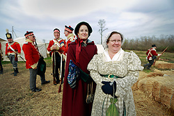 11 January 2015. New Orleans, Louisiana. <br /> Bicentennial reenactment of the Battle of New Orleans in Chalmette. <br /> L/R; Andrea Hurlbut and Kathy Webb with British troops preparing to re-enact their January 8th, 1815 disastrous battle against American foes marking the 200th anniversary of the Battle of New Orleans in Chalmette. Despite heavily outnumbering the Americans, the British suffered over 2,000 casualties, with many senior officers amongst the dead and injured compared to the Americans who suffered a mere 70 by comparison. The American victory was hailed as miracle.<br /> Photo; Charlie Varley/varleypix.com