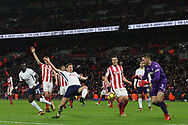 Jan Vertonghen of Tottenham Hotspur (c) has a shot saved by Jack Butland of Stoke City (R). Premier league match, Tottenham Hotspur v Stoke City at Wembley Stadium in London on Saturday 9th December 2017.<br /> pic by Steffan Bowen, Andrew Orchard sports photography.