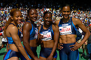 The USA Red women's 4 x 100-meter team (from left) of LaTasha Colander, Chryste Gaines, Inger Miller and Marion Jones pose on the awards podium during the USA vs. The World competition at the 110th Penn Relays at the University of Pennsylvania's Franklin Field on Saturday, April 24, 2004 in Philadelphia.
