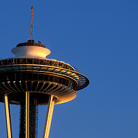 USA, Washington, Seattle, Passenger jet flies past gibbous moon and Space Needle at sunset on autumn evening