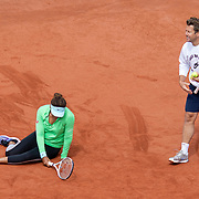 PARIS, FRANCE May 25. Naomi Osaka of Japan slips while practicing on Court Simonne Mathieu with coach Wim Fissette in preparation for the 2021 French Open Tennis Tournament at Roland Garros on May 25th 2021 in Paris, France. (Photo by Tim Clayton/Corbis via Getty Images)
