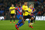 Richarlison of Watford (R) battles with Timothy Fosu-Mensah of Crystal Palace (L). Premier League match, Crystal Palace v Watford at Selhurst Park in London on Tuesday 12th December 2017. pic by Steffan Bowen, Andrew Orchard sports photography.