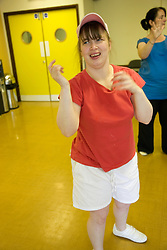 Woman Day Service user with learning disability enjoying a dance class,