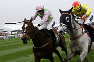 Min (Pink) and the winner Politologue (Yellow)  fight it out in the JLT Melling Steeple Chase at Ladies Day at Aintree, Liverpool, United Kingdom on 13 April 2018. at Aintree, Liverpool, United Kingdom on 13 April 2018. Picture by Craig Galloway.