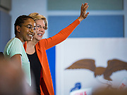 04 NOVEMBER 2019 - GRINNELL, IOWA: US Senator ELIZABETH WARREN (D-MA), right, waves to the crowd at Grinnell College after being introduced by REGINA LOGAN, left, a Grinnell student and President of the Grinnell Student Government Association. Sen. Warren spoke to a crowd of about 850 students and local residents. She brought her campaign to be the Democratic nominee for the US Presidency to the college town of Grinnell, Iowa, Monday. Iowa holds the first selection event of the 2020 presidential election cycle. The Iowa caucuses are Feb. 3, 2020.           PHOTO BY JACK KURTZ