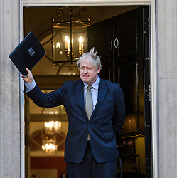 © Licensed to London News Pictures. 13/12/2019. London, UK. British Prime Minister BORIS JOHNSON is seen returning to 10 Downing Street in London after delivering a speech to media, on the day the Conservative party achieved a clear majority in the General Election. A general election was called for December 12th following a deadlock in Parliament over the UK's decision to leave the EU. Photo credit: Ben Cawthra/LNP