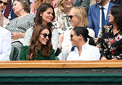 July 12, 2019 - London, ENG, USA - LONDON, ENGLAND - JULY 13:  Kate, Duchess of Cambridge, and Meghan, Duchess of Sussex enjoying the women's singles finals at The Championships, Wimbledon, on July 13, 2019, at the All England Lawn Tennis and Croquet Club in London, England. (Photo by Cynthia Lum/Icon Sportswire) (Credit Image: © Cynthia Lum/Icon SMI via ZUMA Press)