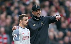 Liverpool manager Jurgen Klopp (right) speaks with Liverpool's Xherdan Shaqiri on the touchline