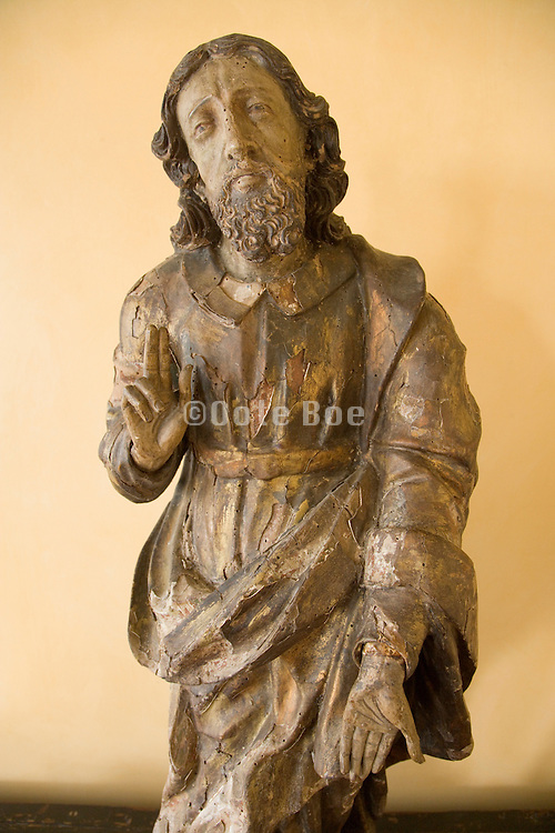 on old wooden sculpture of a blessing Jesus