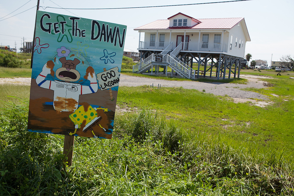 One of a series of signs with a Sponge Bob protesting the BP oil disaster on Grand Isle .