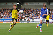Burton Albion defender Tom Naylor (15) is tracked by Sheffield Wednesday midfielder Adam Reach (20) during the EFL Sky Bet Championship match between Burton Albion and Sheffield Wednesday at the Pirelli Stadium, Burton upon Trent, England on 26 August 2017. Photo by Richard Holmes.