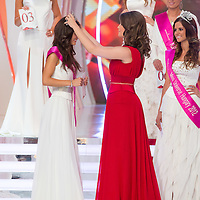 Newly elected Miss World Hungary Tamara Cserhati (L) receives her crown from 2011 winner Linda Szunai (R) after winning a joint beauty contest in Budapest, Hungary on June 9, 2012. ATTILA VOLGYI