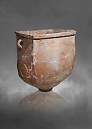 Hittite pottery container with handles from the Hittite capital Hattusa, Hittite New Kingdom 1650-1200 BC, Bogazkale archaeological Museum, Turkey. Grey  background