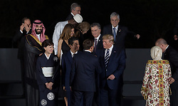 Crown Prince Mohammed bin Salman (Saudi Arabia), wife of Shinzo Abe, Japan's Prime Minister Shinzo Abe, French President Emmanuel Macron and US President Donald Trump during family photo session on the first day of the G20 summit in Osaka, Japan on June 28, 2019. Photo by Jacques Witt/Pool/ABACAPRESS.COM