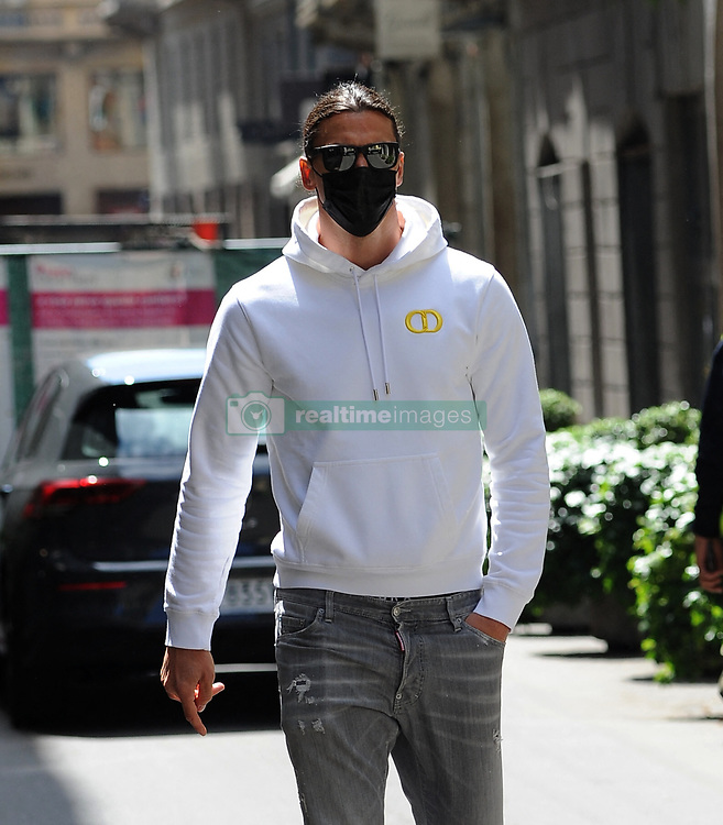Zlatan Ibrahimovic, striker of Milan and the Sweden national team, could play the 2021 European Championships that will start in June. Here he is surprised while having lunch with Ignazio Abate (former Milan defender) and 2 friends in a famous restaurant in the center, Milan, Italy on May 3, 2021. He gave some souvenir photos with some fans, then he goes back home. Photo by Mimmo Carriero/IPA/ABACAPRESS.COM