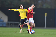 Oxford United midfielder Liam Kelly (28) battles for possession with Swindon Twn Defender Paul Caddis (2) during the EFL Sky Bet League 1 match between Oxford United and Swindon Town at the Kassam Stadium, Oxford, England on 28 November 2020.