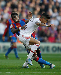 Wilfried Zaha of Crystal Palace (L) and Marcos Rojo of Manchester United in action  - Mandatory byline: Jack Phillips/JMP - 07966386802 - 31/10/2015 - SPORT - FOOTBALL - London - Selhurst Park Stadium - Crystal Palace v Manchester United - Barclays Premier League