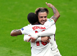 England's Raheem Sterling (left) celebrates scoring their side's first goal of the game with team-mate Jack Grealish during the UEFA Euro 2020 Group D match at Wembley Stadium, London. Picture date: Tuesday June 22, 2021.