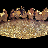 Mycenaean Gold diadem from Grave III, 'Grave of a Women', Grave Circle A, Myenae, Greece. National Archaeological Museum Athens. Black Background<br /> <br /> An impressive Mycenaean gold diadem with repousse rosettes and thin sheets applied to the top. .Cat No 1. 16th century BC.<br /> <br /> Shaft Grave III, the so-called 'Grave of the Women,' contained three female and two infant interments. The women were literally covered in gold jewelry and wore massive gold diadems, while the infants were overlaid with gold foil.
