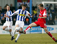 Photo: Chris Ratcliffe.<br />Colchester United v Swindon Town. Coca Cola League 1. 18/03/2006.<br />Pat Baldwin (L) of Colchester tussles with Andrew Nicholas of Swindon