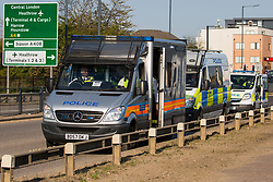 London, UK. 19th April, 2019. Police vehicles alongside the A4 close to Heathrow airport. A large policing operation was put in place in and around the airport in preparation for expected protests by climate change activists from Extinction Rebellion. Only a very small symbolic protest by teenage activists from Extinction Rebellion Youth took place, dispersed by police officers under threat of arrest.