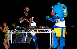 Usain Bolt and Commonwealth Games mascot Borobi the blue koala on stage during the Closing Ceremony for the 2018 Commonwealth Games at the Carrara Stadium in the Gold Coast, Australia.