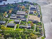 Nederland, Noord-Holland, Zaandam, 07-05-2021; Hembrugterrein van voorheen Eurometaal, wapen- en munitiefabriek. Ook bekend als Artillerie-Inrichtingen, oorspronkelijk onderdeel van de Stelling van Amsterdam, veel van gebouwen zijn monumenten. Op het terrein vinden tegenwoordig evenementen en festivals plaats en het terrein doet inmiddels ook dienst als een stadspark. <br /> Hembrug site of the former Eurometaal, weapons and ammunition factory. Also known as Artillerie-Ininrichting, originally part of the Defense Line of Amsterdam, many of the buildings are listed buildings. Nowadays, events and festivals take place on the site and the site now also serves as a city park.<br /> <br /> luchtfoto (toeslag op standard tarieven);<br /> aerial photo (additional fee required)<br /> copyright © 2021 foto/photo Siebe Swart