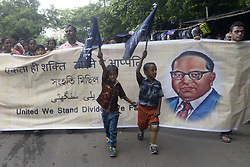 July 13, 2017 - Kolkata, West Bengal, India - Child with prosthetic leg walks with other in the  integrity rally in Kolkata. Activist of West Bengal Handicap Rights Commission takes part integrity rally call ''United We Stand Divided We Fall'' for harmony and peace on July 13, 2017 in Kolkata. (Credit Image: © Saikat Paul/Pacific Press via ZUMA Wire)