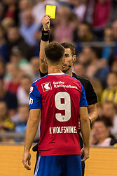 referee Georgi Kabakov gives Ricky van Wolfswinkel of FC Basel a yellow card during the UEFA Europa League third round qualifying first leg match between Vitesse Arnhem and FC Basel at the Gelredome on August 09, 2018 in Arnhem, The Netherlands