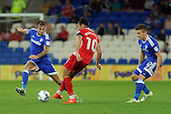 Cardiff City's Joe Ralls (l) tackles Blackburn's Ben Marshall  (c). EFL Skybet championship match, Cardiff city v Blackburn Rovers at the Cardiff city stadium in Cardiff, South Wales on Wednesday 17th August 2016.<br /> pic by Carl Robertson, Andrew Orchard sports photography.