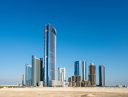 View of modern skyscrapers under construction at new business district called City of Lights on Al Reem Island in Abu Dhabi United Arab Emirates